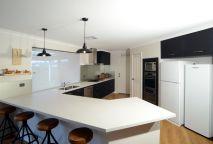 Kitchen: Matt Black doors, Hi-Macs benchtops